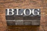 blog word in mixed vintage metal type printing blocks over grunge wood